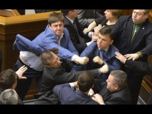 Picture of people in suits fighting